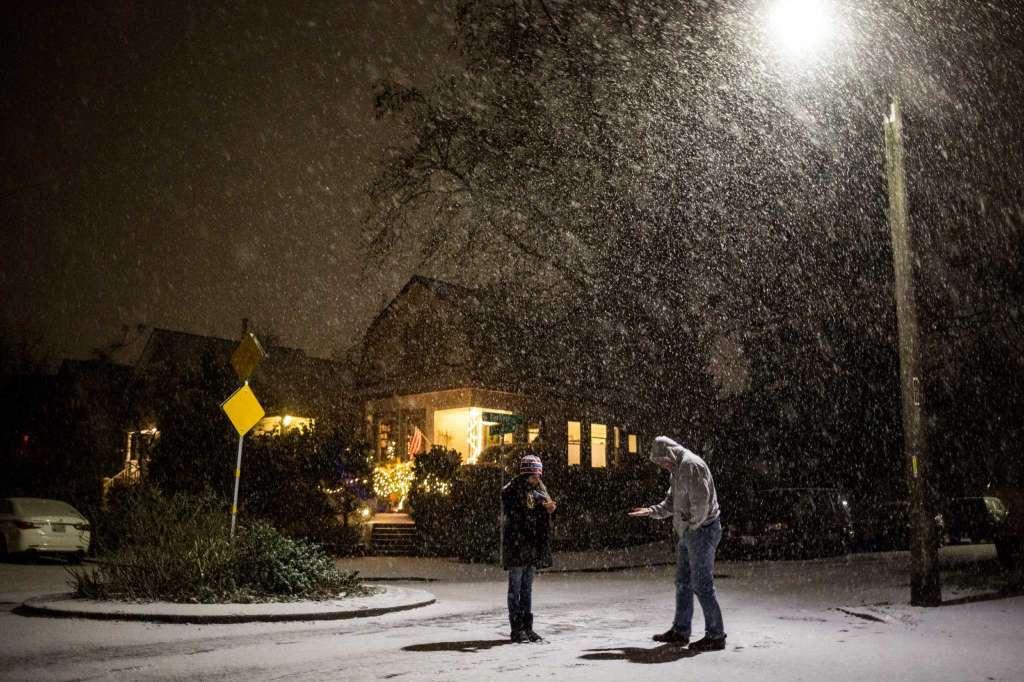 Snowy roads snarl travel around Seattle; schools closed, delayed