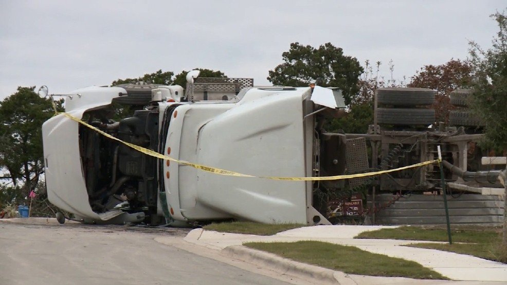 18-wheeler dump truck tips over and kills man
