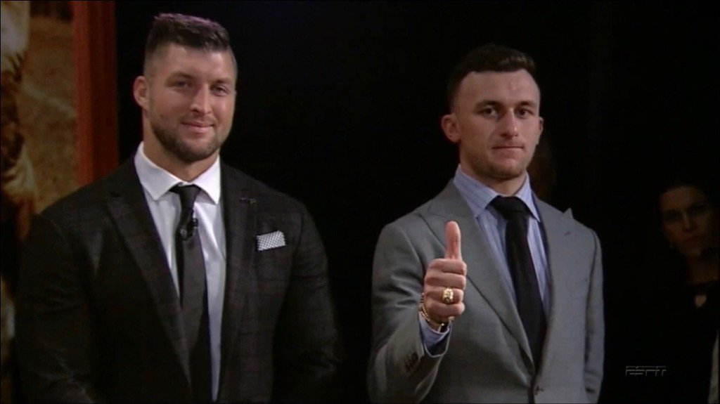 Heaven meets Hell in one photo. #HeismanTrophy #tebow #manziel https://t.co/WSm3Phdnnn