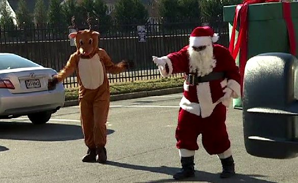 Santa shows off his best dance moves during special visit to Arlington --->