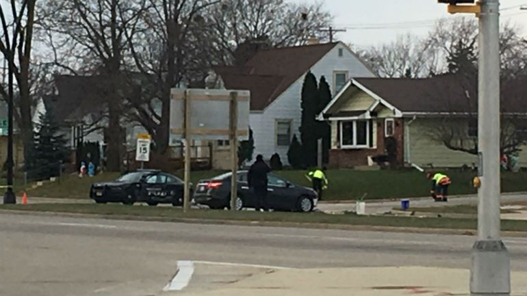 2 Greenfield police officers injured after squad struck by vehicle