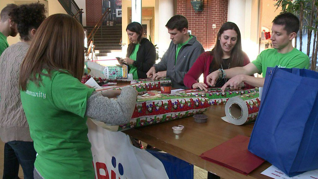 """""""Such a good cause:"""" Kind-hearted volunteers wrap gifts for the Boys and Girls Club"""