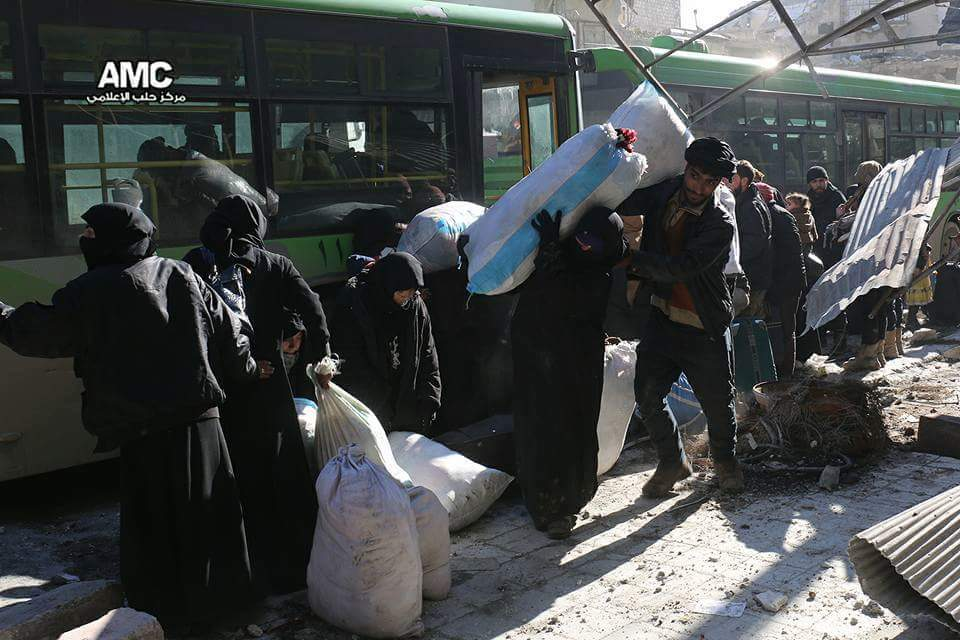 Photos: Syrians leaving the city of Aleppo after years of suffering, most likely to never return