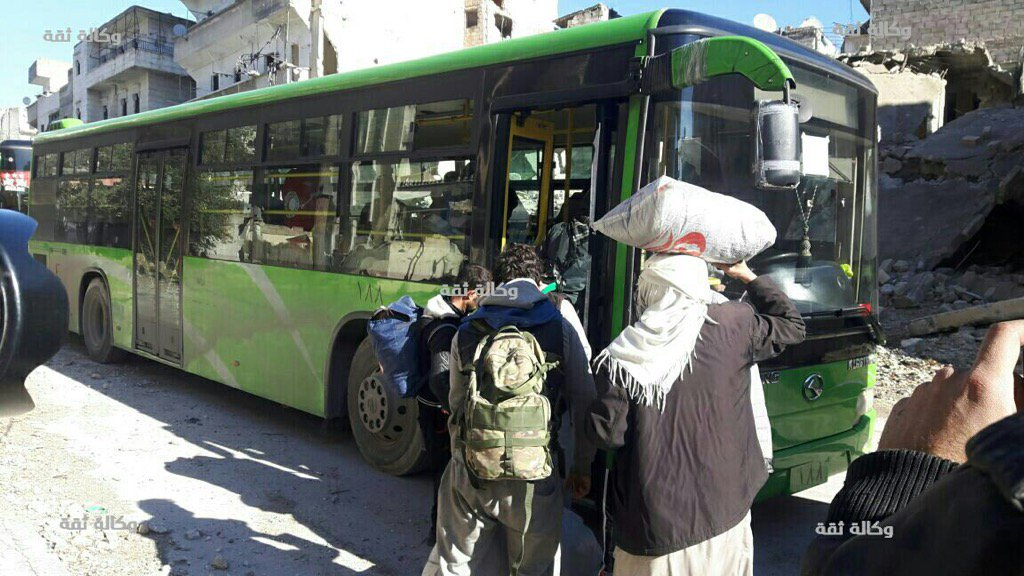 Photo by the opposition's Thiqa agency shows People boarding buses in Aleppo Syria