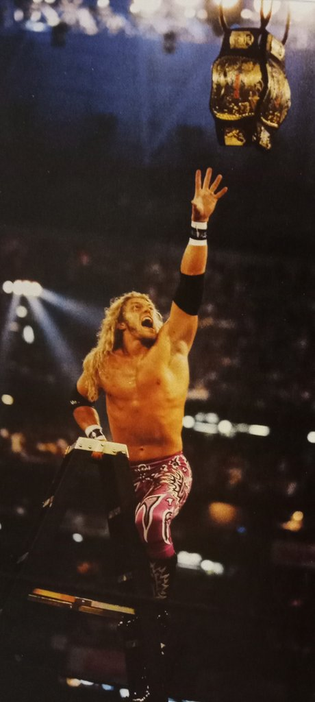 "Edge,reaching for the WWF World Tag Team Titles during the chaotic ""TLC II"" Tables,Ladders and Chairs match at WrestleMania X-Seven"