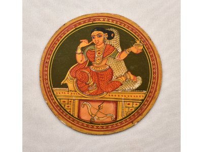 Circular ''ganjifa'' or playing card from 20th century, painted to depict a female figure in a dance posture holding a pot in her left hand, with bow and arrow underneath her seat #ganjifa #playingcardsofIndia