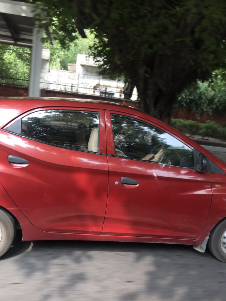 @dtptraffic I read in papers that driver of a SUV involved in a hit and run that led to death of a man driving a scooter was not only drunk but was checking out videos. On Zakir Hussain road at about 9.42 am this girl texted while driving even on India Gate. Can DP take action