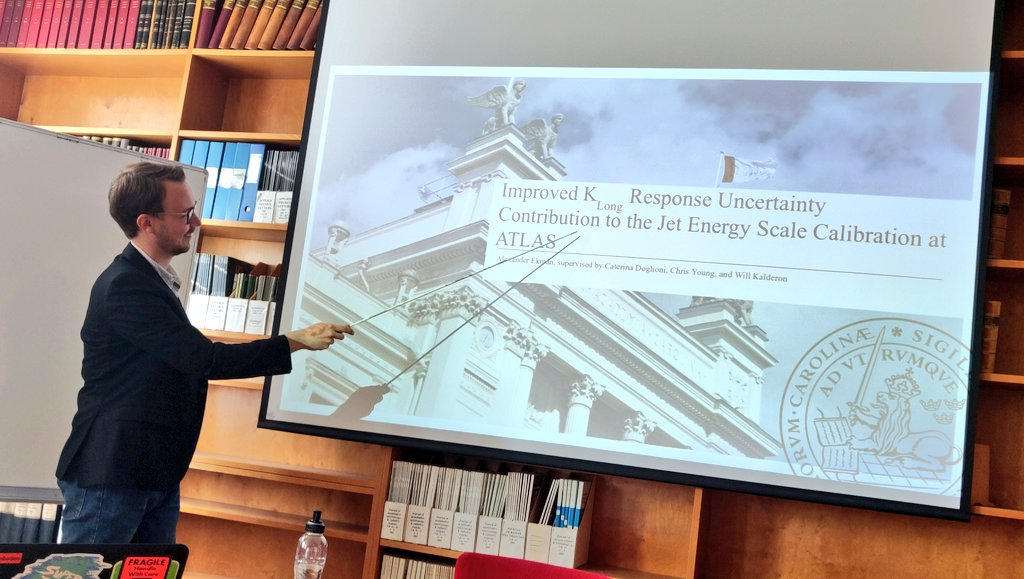 The last two of this year's masters students at the @lunduniversity particle physics division defend their thesis brilliantly, and are rewarded with a degree and a paj full of π