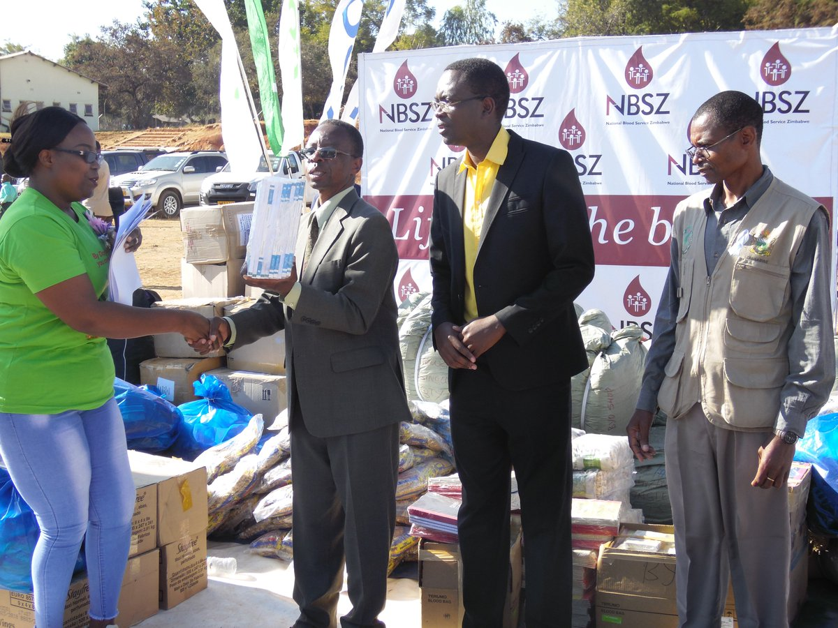 NBSZ CEO Lucy Marowa @LeeAnnMarch hands over #CycloneIdai donations to Edgars Seenza Manicaland Provincial Administrator representing Hon Dr. Ellen Gwaradzimba Minister of State Provincial Affairs Manicaland Province during Zimbabwe #WorldBloodDonorDay celebrations