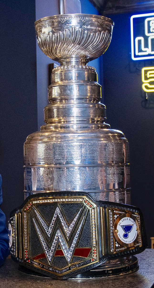 'Cause a championship trophy needs a championship belt. Thanks @WWE! #stlblues #StanleyCup