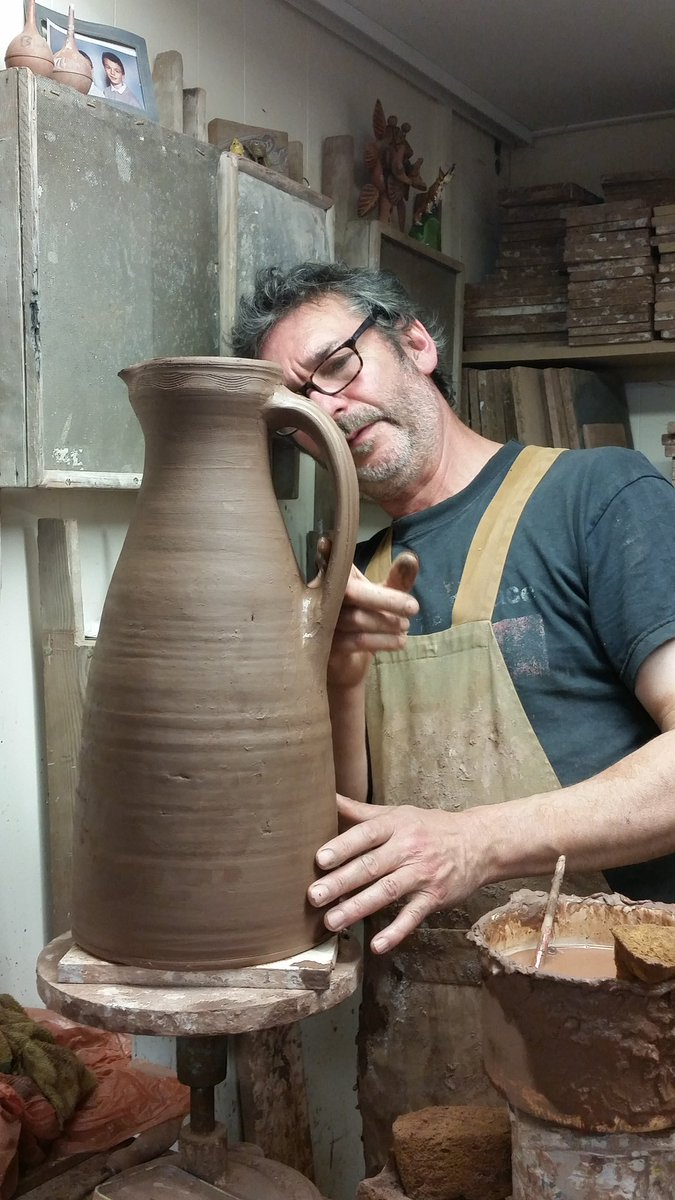 Tonight's job, putting handles on some tall tapered jugs that I threw this morning. The inspiration for these is a fine medieval jug that was made at Mill Green in Essex. Sadly, mine is not a patch on the original, damn those medieval potters! #slipware  #fitchandmcandrewonline