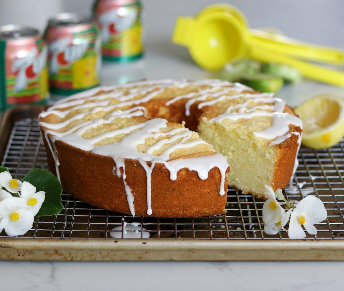 """7-Up Pound Cake. This recipe uses 7-Up AND boosts the flavor with the zest and juice of fresh lemons & limes. And like a proper pound cake, the recipe includes lots of eggs, butter & sugar. Ideal for BBQs, baby showers & retro parties. Recipe """"The Perfect Cake"""" @testkitchen<br>http://pic.twitter.com/CQdtYaoP7s"""