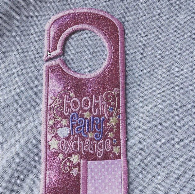 Andrea made this pretty door hanger using our tooth fairy door hanger from https://www.bunnycup.com/embroidery-design-Door-Hangers ….    #bunnycup #bunnycupembroidery #vinyl #embroidery #machineembroidery #embroiderydesigns #toothfairy #doorhanger #toothfairydoorhanger