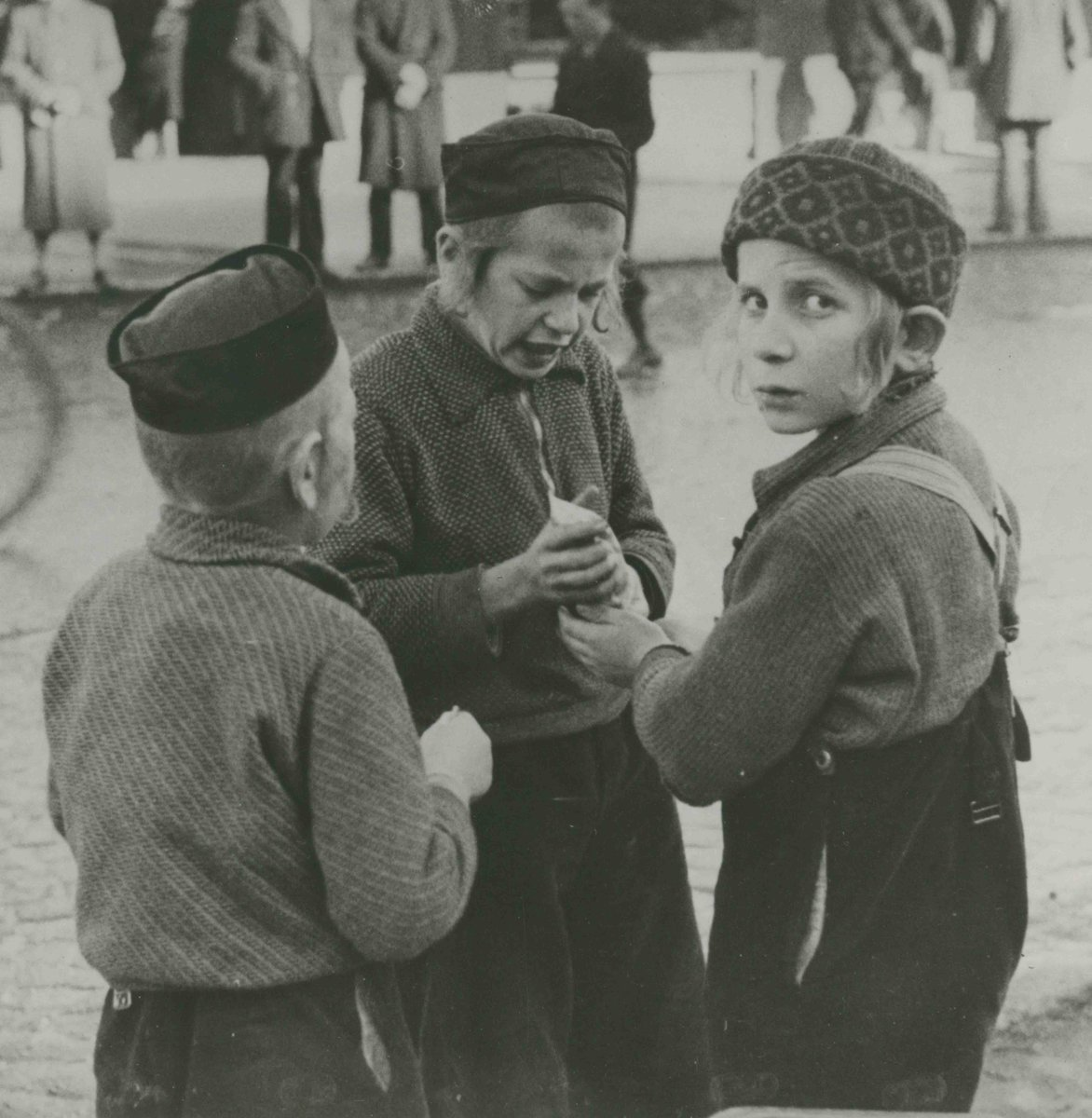 Three boys in one of the Jewish Ghettos of Poland, early 1940s. Image from Collection I-433.