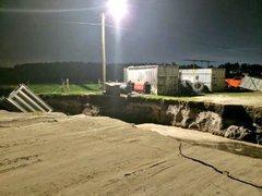 Hole across Boggy Creek Rd.