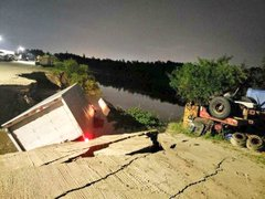 Box truck swallowed by hole in the road.