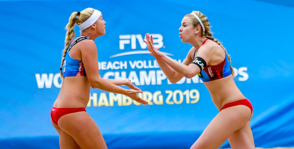 d51cb5c332 Beach volleyball players Sara Hughes and Summer Ross celebrate