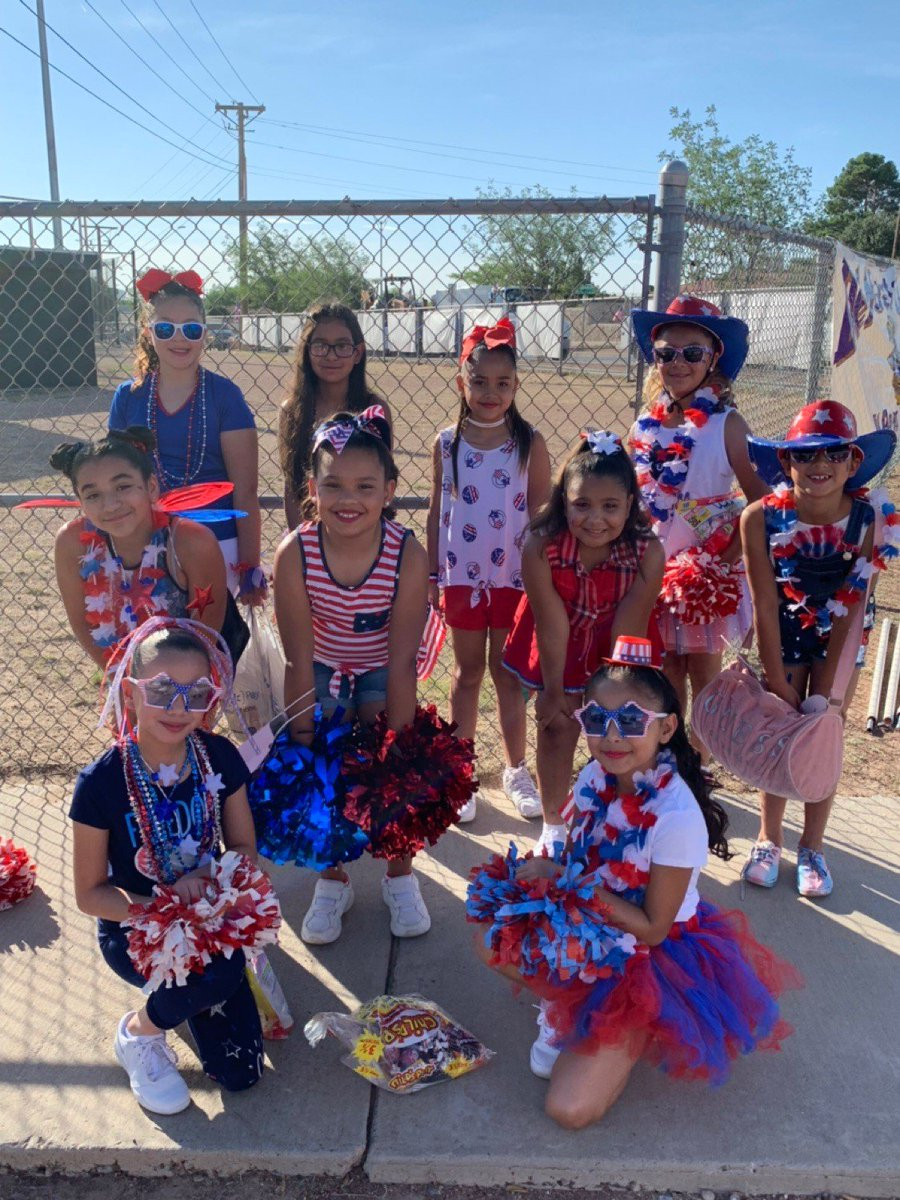 Aztec Cheerleaders in action at the 4th of July parade. Happy Fourth of July!