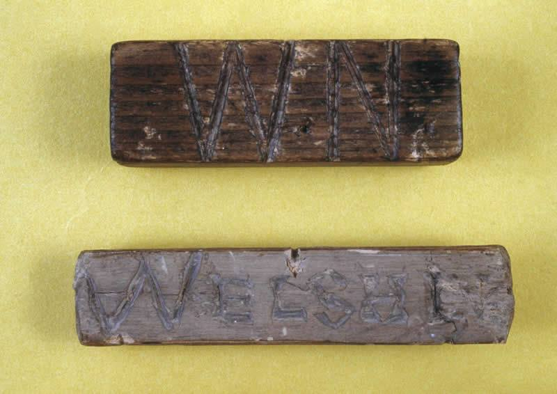 """This is a """"Welsh not"""".It was worn on a rope. If a child was found to be speaking Welsh in school, they would be made to wear this around their neck and caned. it was beaten out of us! This is why the Welsh can't speak Welsh, this, purgings, are the reason why."""