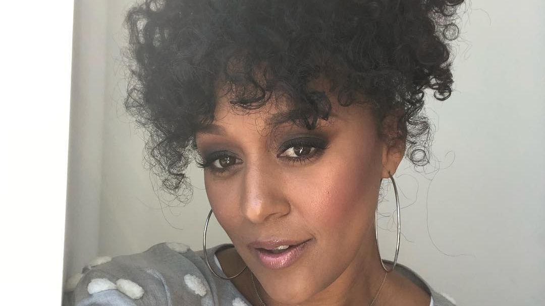 Do you like to rock your curls up or down? We love @tiamowry's pinned up hairstyle 🥰  #tiamowry #curlyhair #curls #updo #curlyhairstyles #naturalhair