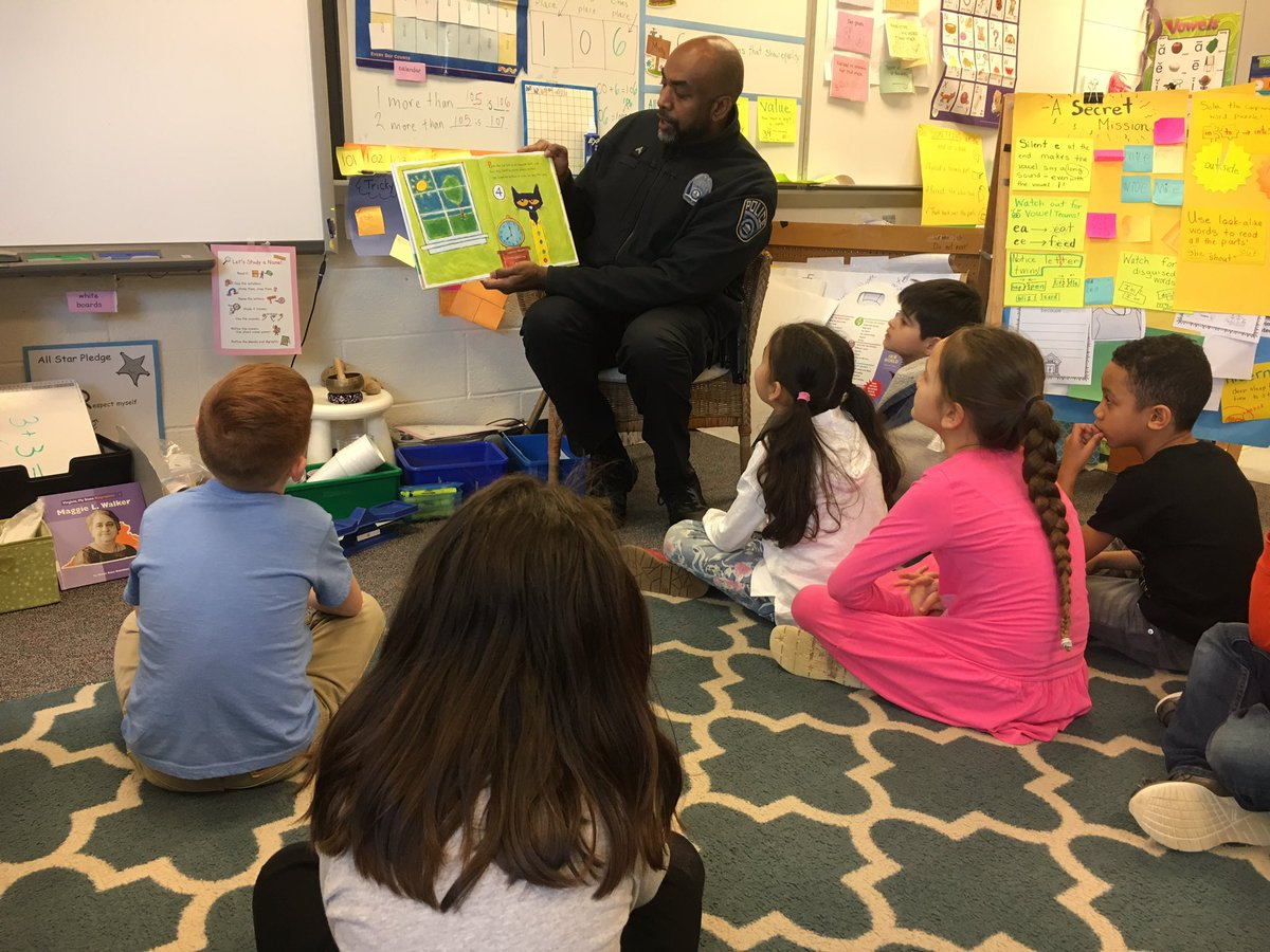 "Enjoying ""Go Dog, Go""  and ""Pete the Cat"" with School Resource Officer Blow for Read Across America Day! <a target='_blank' href='http://twitter.com/HFBReading'>@HFBReading</a> <a target='_blank' href='http://search.twitter.com/search?q=HFBTweets'><a target='_blank' href='https://twitter.com/hashtag/HFBTweets?src=hash'>#HFBTweets</a></a> <a target='_blank' href='http://search.twitter.com/search?q=ReadAcrossAmerica'><a target='_blank' href='https://twitter.com/hashtag/ReadAcrossAmerica?src=hash'>#ReadAcrossAmerica</a></a> <a target='_blank' href='http://search.twitter.com/search?q=APSisAWESOME'><a target='_blank' href='https://twitter.com/hashtag/APSisAWESOME?src=hash'>#APSisAWESOME</a></a> <a target='_blank' href='https://t.co/2n4XHImB3E'>https://t.co/2n4XHImB3E</a>"