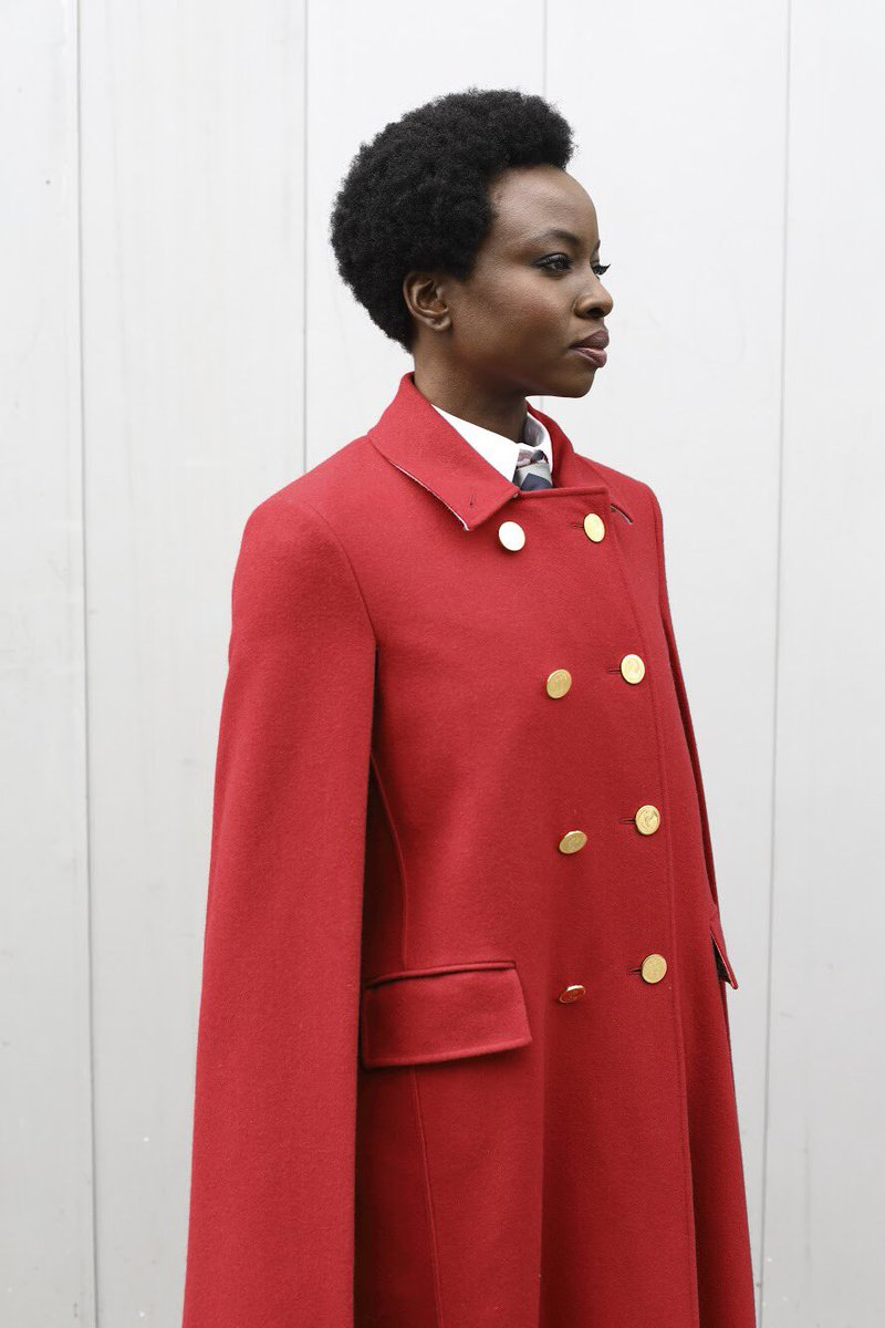 eabcc2949f ... danai gurira wears a thom browne red high-button double breasted cape  and leather bow mules to the women's fall 2019 runway show ph:  #elodiechapuis ...