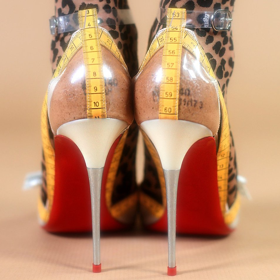 35640caf794 ... Christian Louboutin s yellow and white Metrisandal heels are a playful  ode to the exacting craftsmanship of the house s Parisian atelier ...