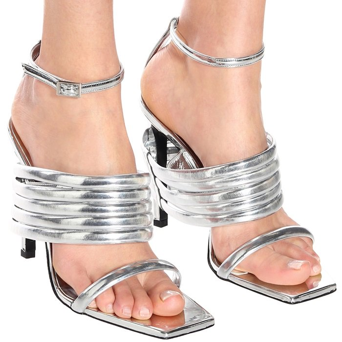 e46c22cee5f They re set on a high coated heel and have a square-toed silhouette