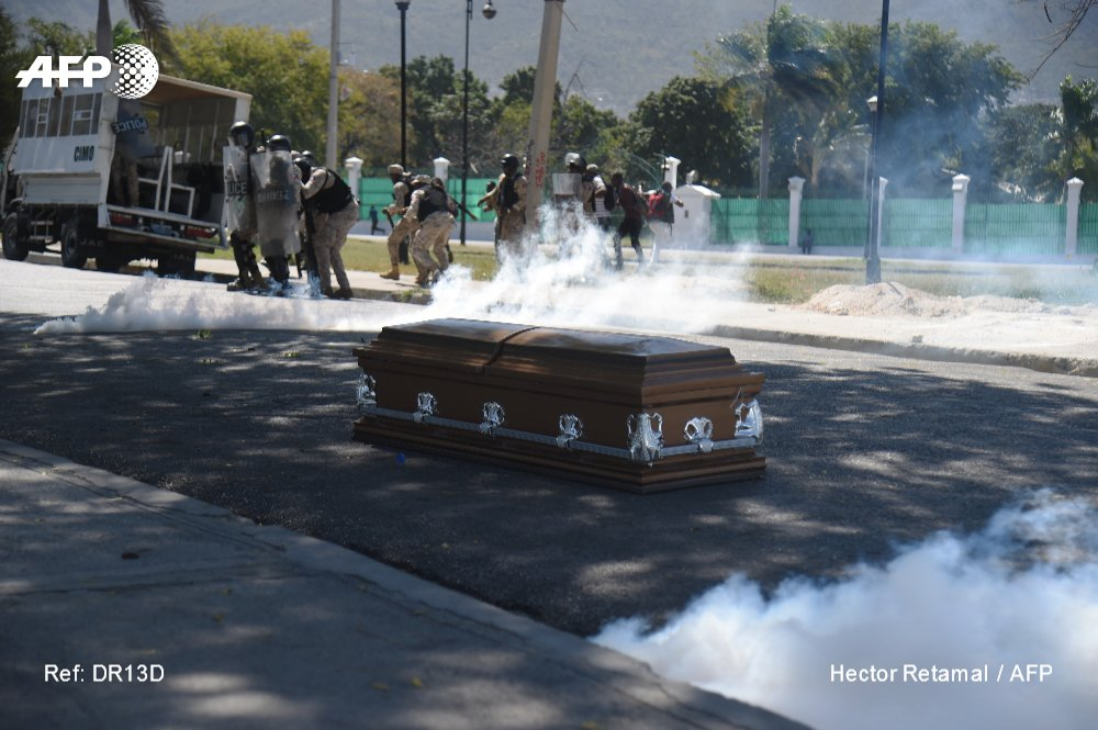 In Haiti, mourners for a man killed during demonstrations against President Jovenel Moise abandoned a coffin in the street when police fired tear gas, participants said