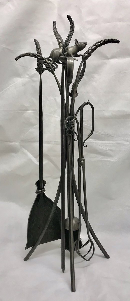 Mouse and Wheat Companion Set  Completed commission on its way to Scotland! Set includes 4 Fireside Tools - Poker Brush Shovel  Log Tongs  The customer wanted this popular design taller than I normally make it, creating an elegant but useful hearth feature. @KvBlacksmith #fire