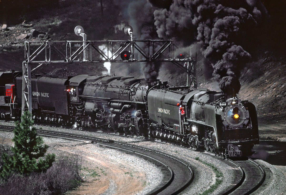 On their way to Railfair &#39;81 and the California State RR Museum&#39;s dedication, @UnionPacific 4-8-4 #8444 and 4-6-6-4 #3985 muscle up Donner Pass at Coldstream Canyon in April, 1981. Both locomotives are equipped with @Timken roller bearings on their main drivers. Roger Puta photo. <br>http://pic.twitter.com/E8wAnK70Gk