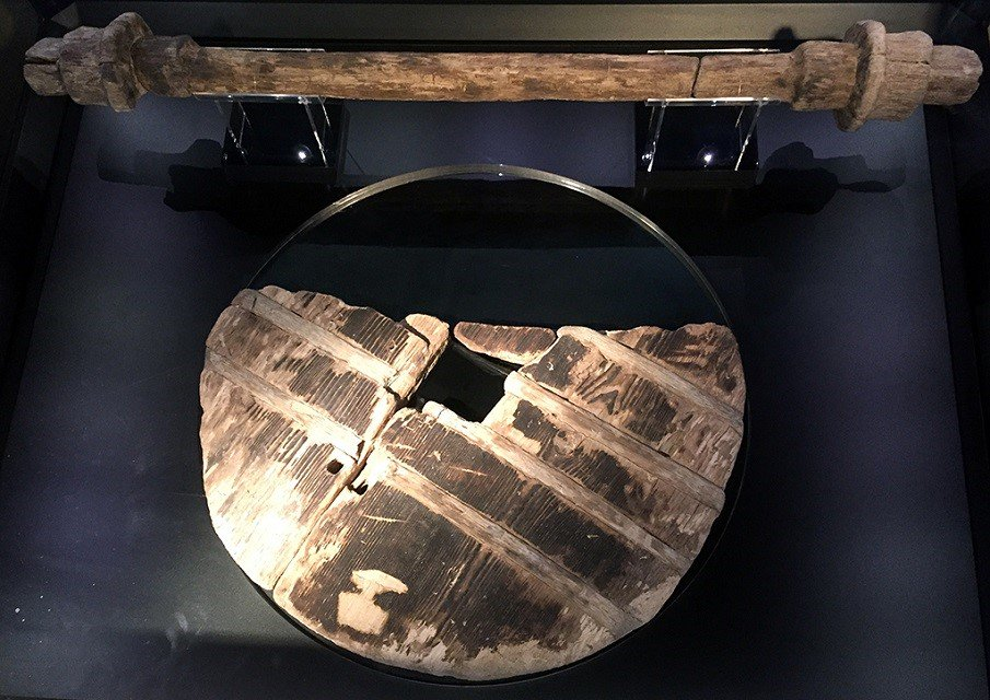 The world's oldest known wheel, 5,000+ years old, found with axle in boggy soil of Slovenia's Ljubjana Marshes. Its craftmanship suggests that wheels had been invented much before this. Made of oak &amp; ash, w/ radius of 70cm, probably used on ox cart. At R, a reconstruction <br>http://pic.twitter.com/Z1yRarKJJr