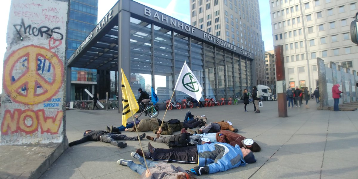RIGHT NOW: #ExtinctionRebellion is conducting a die-in at Potsdamer Platz.   The climate crisis will lead to the deaths of millions. The time to act is now.  #XRBerlin<br>http://pic.twitter.com/Ro6gdQVyLU