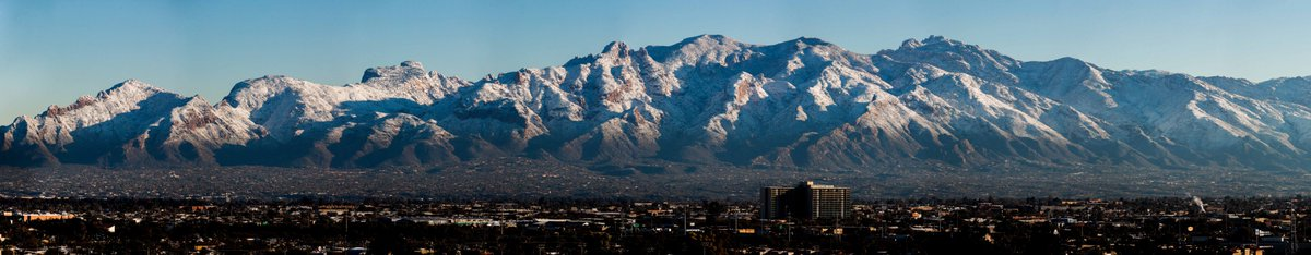 The snow-capped Santa Catalina Mountains show off in the morning light following yesterday&#39;s winter storm in #Tucson.  (Panorama made from nine photos shot at 400mm) #azwx<br>http://pic.twitter.com/4aJ6tgN2Lu