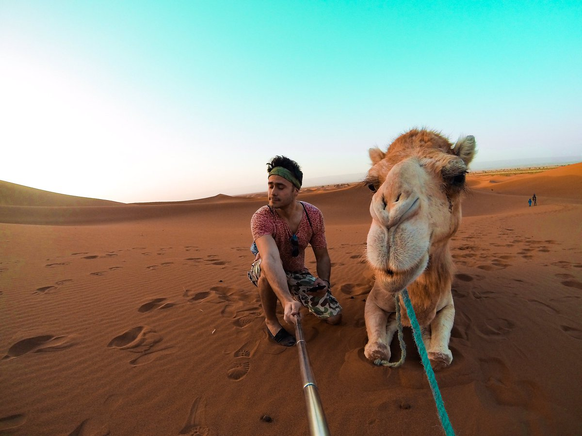 This is Jenny!🐪😃 We were arguing a bit before this #selfie but we are totally fine now! #couplegoals❤  From 1-10 how beautiful you think she is? #saharadesert #camel #merzouga #morocco #greekvlogger #greekyoutuber #traveler #traveling #desert #sahara #dunes #sand #deserttrip