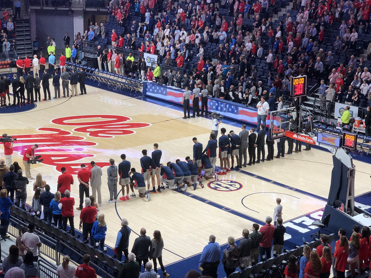 Ole Miss basketball players kneel during national anthem