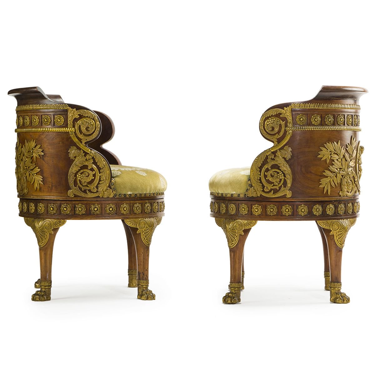 A pair of French Empire mahogany and gilt bronze-mounted fauteuils de bureau. . After the design by François-Honoré-Georges Jacob-Desmalter for Jérôme Bonaparte, King of Westphalia and brother of Napoleon Bonaparte. . #fauteuils #frencharmchairs #onlineauction #auction
