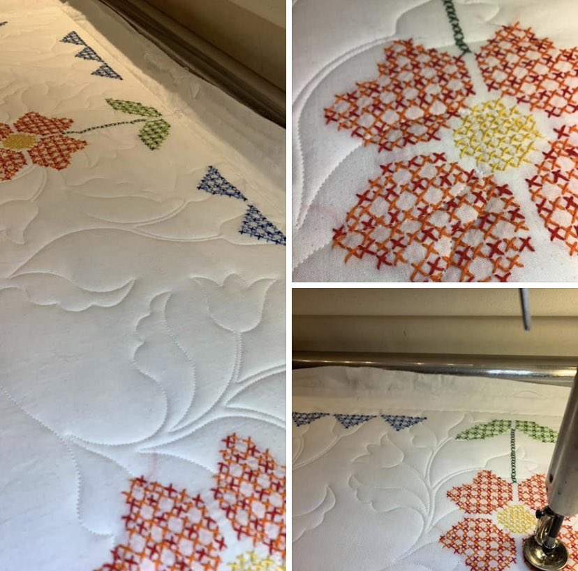 This vintage hand cross-stitched quilt top is finally being quilted and ready to be enjoyed by a great granddaughter! The Superior Threads So Fine thread sinks right into the cross stitching and batting letting all of the loving hand stitched work shine. #crossstitchquilt