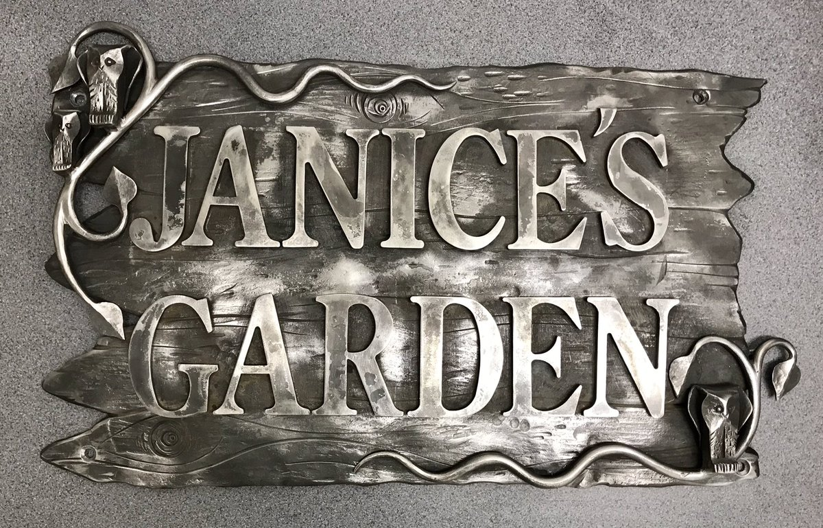 Garden Sign Custom made exterior sign with Owl & Leaf design. This piece is fairly large and heavy, making it a substantial, quality feature for the garden. 3 little Hand Forged Owls sit amounts curled leaves and tendrils, on a back plate of wood textured steel.  To be galvanised