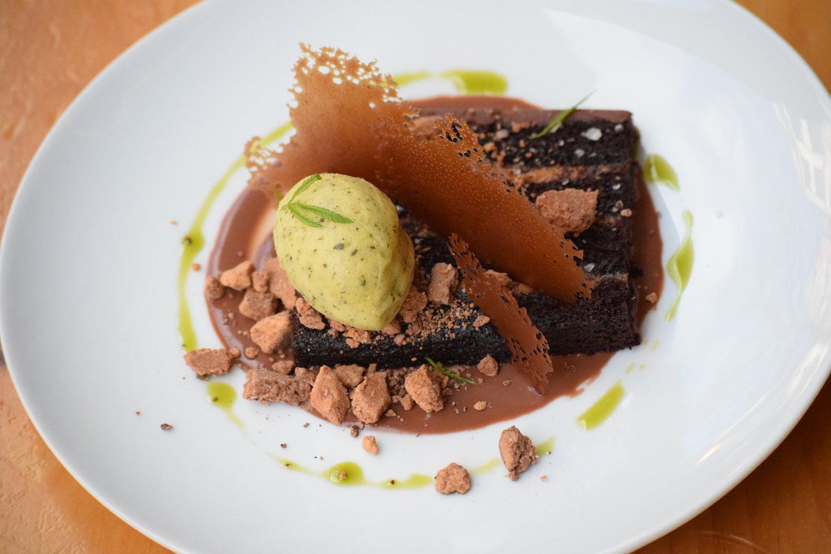 #Treatyoself to our newest dessert! Our Torta de Chocolate - aka #chocolate heaven - features Fortunato 68% dark chocolate, Macambo white chocolate, & cacao nibs as well as passion fruit accents in the #sorbet... Amazing!
