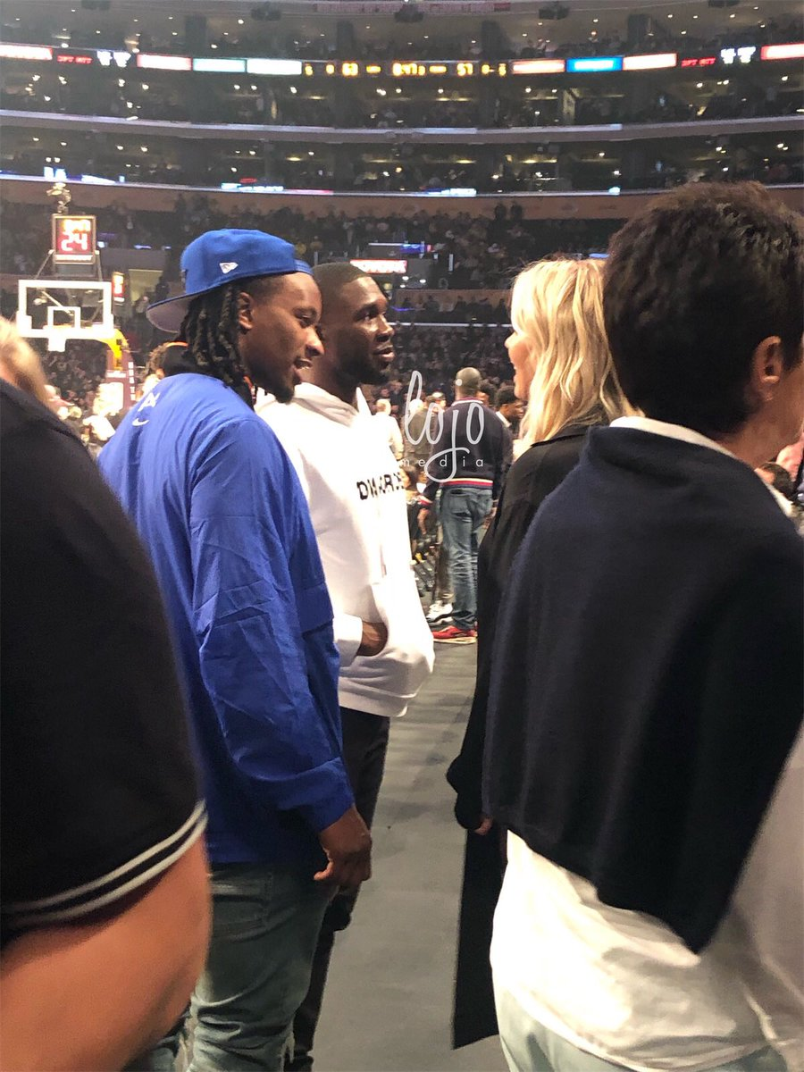 Todd Gurley (@TG3II) and Nelson Agholor (@nelsonagholor) talking to @JeanieBuss during halftime of the #Lakers game