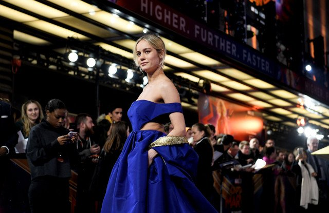 15c7d030b0a7 Brie Larson wore a custom blue and gold Valentino gown at the premiere of  Captain Marvel