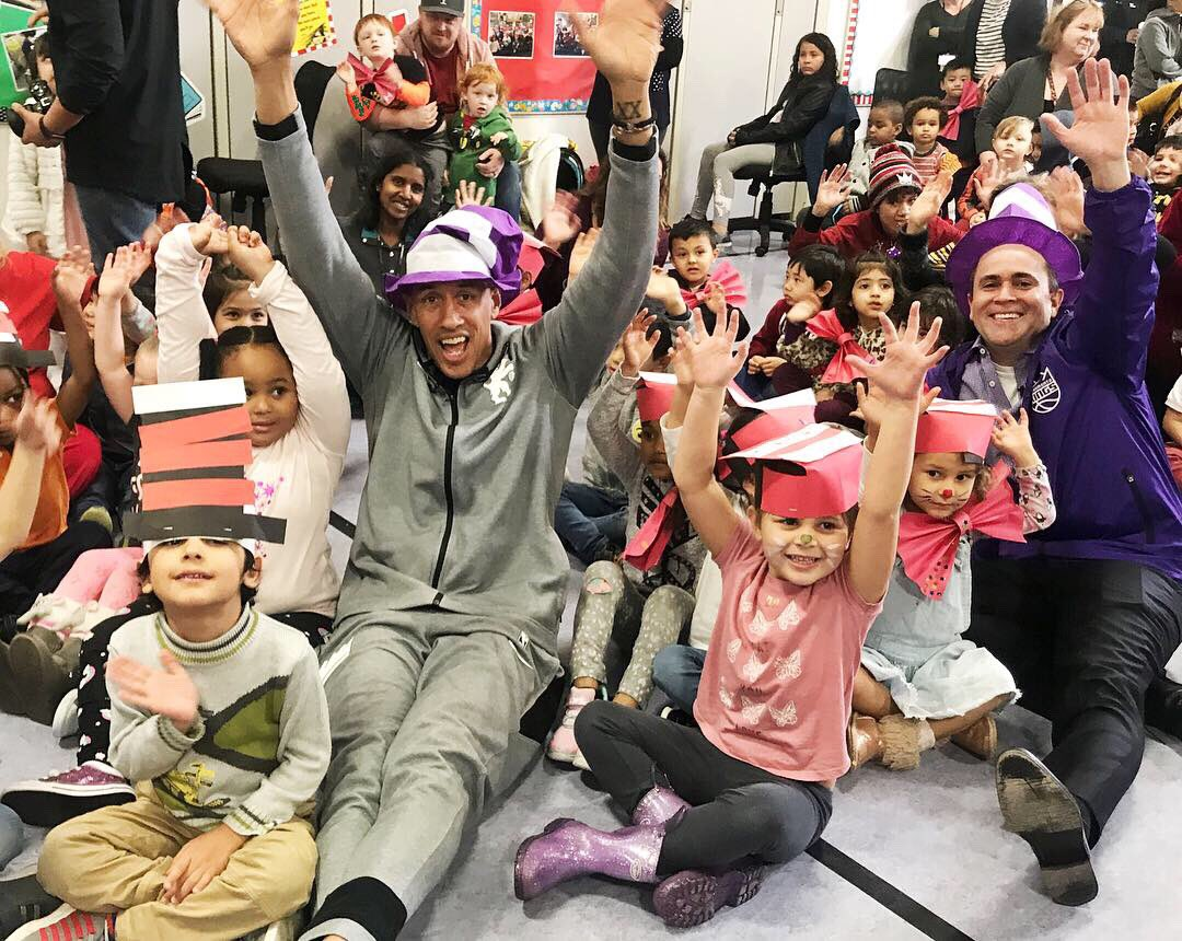 The @sacramentokings celebrated #ReadAcrossAmerica today!  Kings Legend @TheDougChristie, President @JohnRKings, coach's family members, Jr. Kings coaches, @Kings_Dancers & Kings employees teamed up with @First5Sac to teach the importance of reading to students in the community!