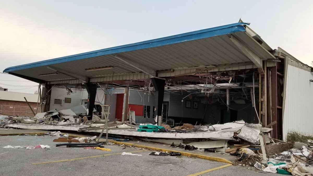 Still surreal driving in #PanamaCity. Took off a week with son for #SpringBreak. Pulled over to text and looked to my right and thought, &quot;What was that?&quot; It was Lee&#39;s Taekwondo for 30 years or so, I&#39;m just now noticing it was destroyed. Something new everyday. #hurricanemichael<br>http://pic.twitter.com/IUh30HpvZI