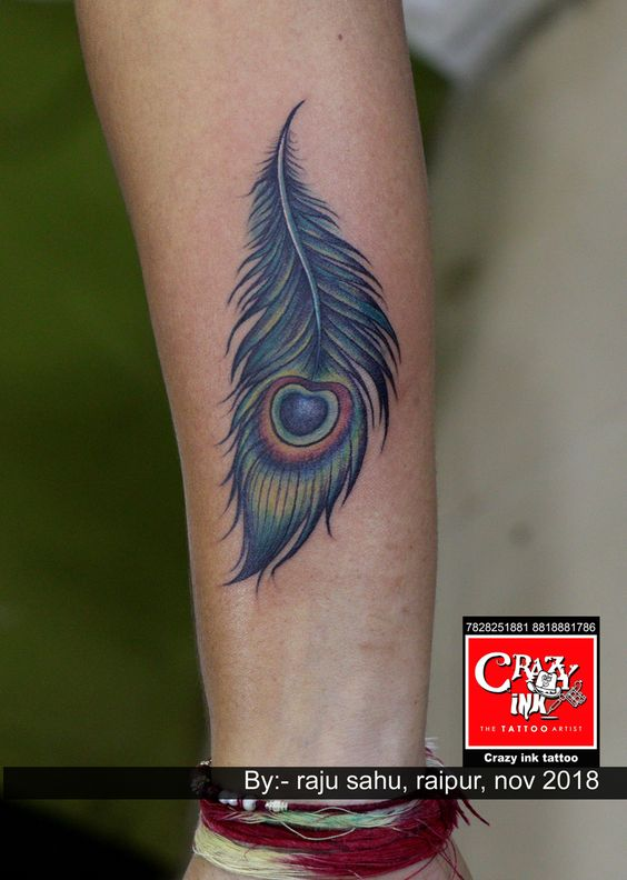 d82f6fab4 Most popular creative color Peacock feather tattoo. Done by tattoo artist  Raju sahu. Done at crazy ink tattoo. #peacockfeather #peacock  #feahtertattoo ...