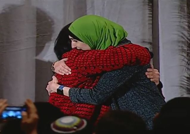 This image is @lsarsour hugging Palestinian terrorist Rasmea Odeh, who murdered two Jewish students, at anti-Zionist @jvplive national meeting, where Odeh was honored https://legalinsurrection.com/2019/03/germany-to-deport-palestinian-terrorist-rasmea-odeh-at-urging-of-u-s-ambassador-richard-grenell/ …
