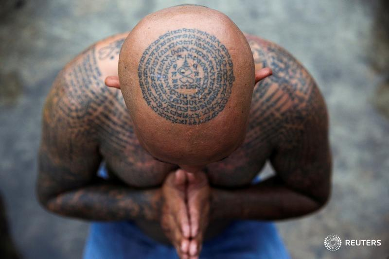 A devotee attends the religious tattoo festival, where devotees believe that their tattoos have mystical powers, in Thailand, and more photos of the day: https://t.co/gXoex1N3Xl 📷 @Athit_P https://t.co/rZm3krnyVn