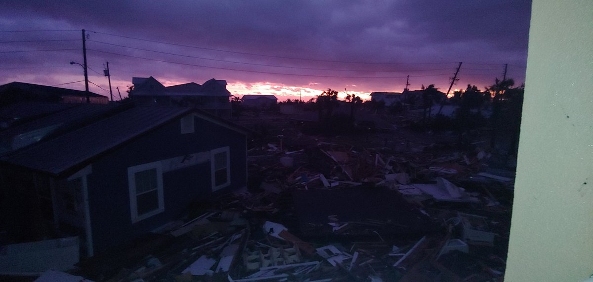 Sun sets over the catastrophic devastation left in the wake of the brutalizing force of #HurricaneMichael in #MexicoBeach, #flwx; on the evening of October 10, 2018.<br>http://pic.twitter.com/LqNCqSaSvB