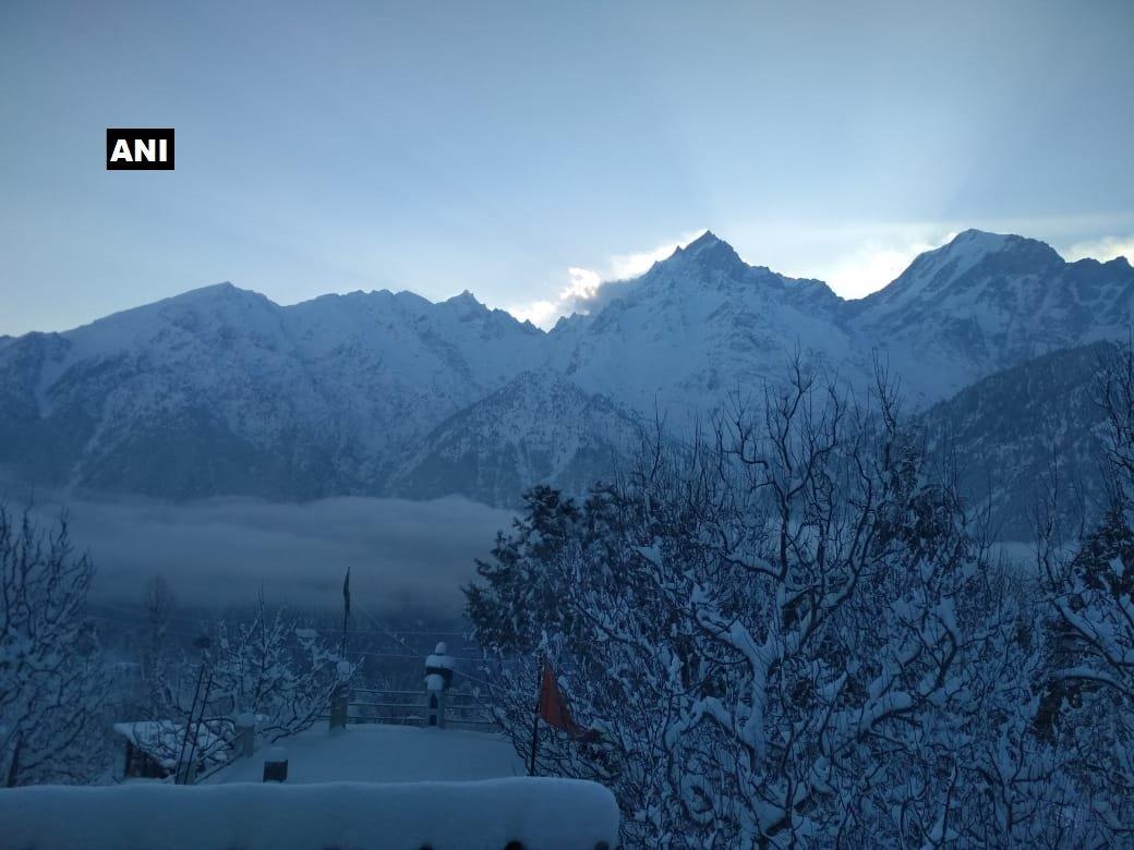 Himachal Pradesh: #Visuals of fresh snowfall from Kalpa in Kinnaur district