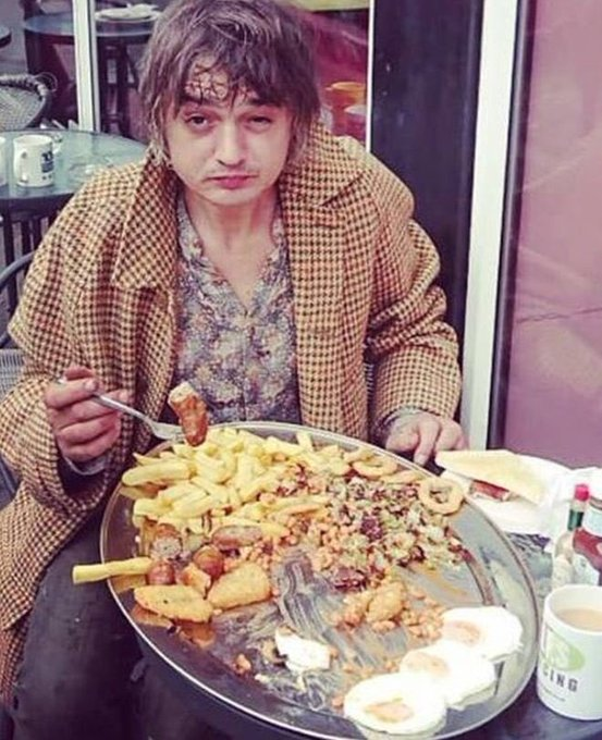 Happy birthday to pete doherty. a man who lives like this so that we don t have to. a true saint.
